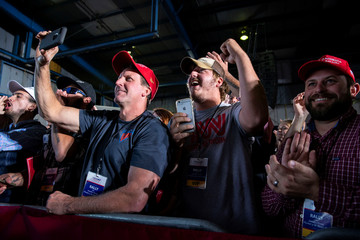 People cheer as U.S. President Donald Trump speaks during a campaign rally at Southern Illinois Airport in Murphysboro