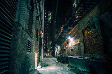 Fototapete - Dark and eerie downtown urban city alley at night