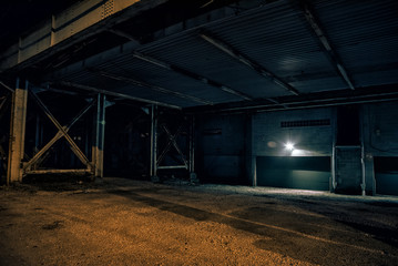 Wall Mural - Dark and empty urban city lot under a vintage railway bridge at night