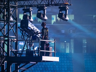 A man controls the lighting equipment. Checking stage equipment. Concert equipment. Director of the world.