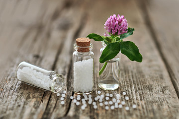 Homeopathic granules and small flowers.