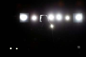 U.S. President Donald Trump departs after speaking at a campaign rally at Southern Illinois Airport in Murphysboro
