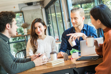 Young businessman and woman meeting and share idea to colleague