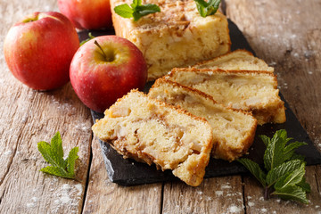 Baked sweet apple bread pie with cinnamon and mint close-up. horizontal