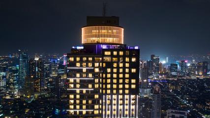 Beautiful skyscraper with glowing light at night