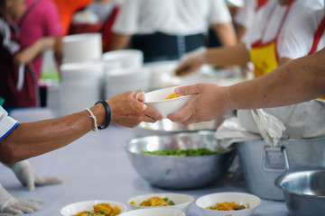 People who are rich and mentally assisting people in society, sharing food for the hungry : Help and Donation Concepts