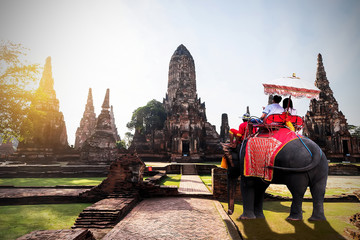 Foreign tourists Elephant ride to visit Ayutthaya, There are ruins and templesi in the Ayutthaya period.Concept is Travel in temple Chaiwatthanaram.