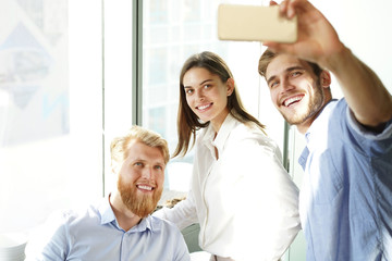 Group shot of colleagues having fun in their office.