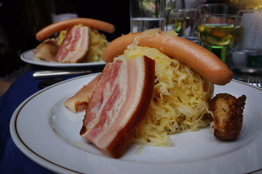 Choucroute garnie, a typical alsacian plate, with sausages, bacon, sauerkraut and potatoes