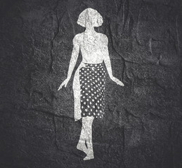 Sexy woman silhouette in dress textured by polka dot pattern. Walking lady