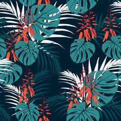 Seamless tropical pattern, vivid tropic foliage, with palm monstera leaves, exotic orange flower in bloom. Vintage dark blue background.