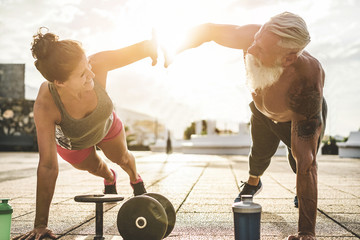 Couple of fitness athlete doing workout sessions outdoor at sunset
