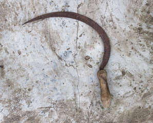 Sickle on concrete background, cement background, sickle
