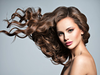 Face of a beautiful  woman with long flying   hair