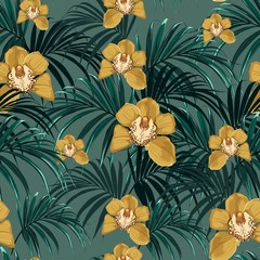 Seamless pattern, yellow orchid flower and green exotic palm monster leaves on vintage green background.
