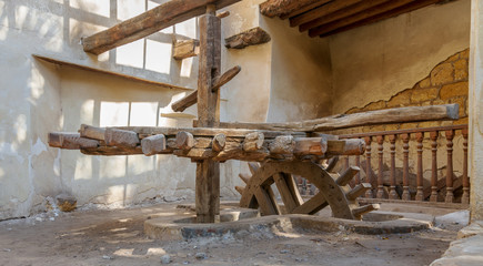 Ancient rotary Flour Mill used to be rotated by animal power in front of El Sehemy historic house, El Moez street, Cairo, Egypt