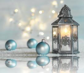 Christmas background with Christmas balls, lantern and reflection.