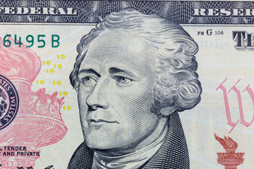 Alexander Hamilton on the ten dollar bill macro photo. United States of America currency detail.