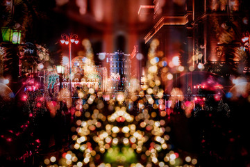Street decorated for Christmas in city, balls and lights on Christmas tree