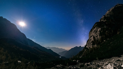 stars and milky way with moon light over mountain night landscape. night panorama. Nightscape