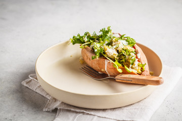 Quinoa Stuffed Sweet Potatoes with Kale and avocado, copy space.