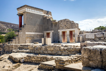 Red columns of the Knossos palace. Fragment of the ruins of the Knossos palace. Architecture on Crete, Greece.