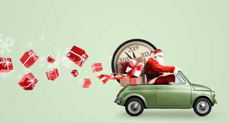 Christmas countdown arriving. Santa Claus on car delivering New Year gifts and clock at green background