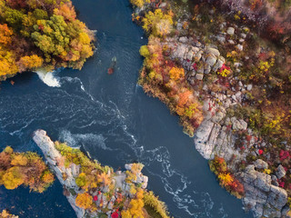 aerial drone view of colorful forest, blue river and rocks. beautiful autumn landscape