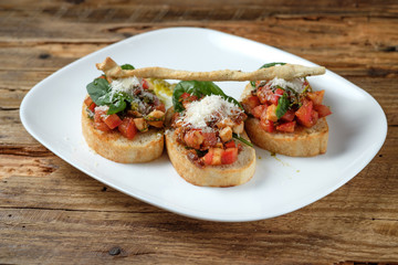 Bruschetta with fresh tomatoes, parmesan and basil
