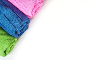 Colorful cotton terry towels on a white background. Flat lay beauty photo for spa and massage salon