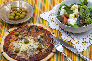 pitted olives margarita pizza with olives and cottage cheese with olives and tomatoes fresh green salad close-up