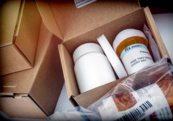 Several boxes with medicines in interior under prescipcion medica, conceptual image