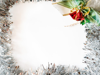 New Year, Christmas background, tinsel  and red bells on white background. Holiday banner with space for text.