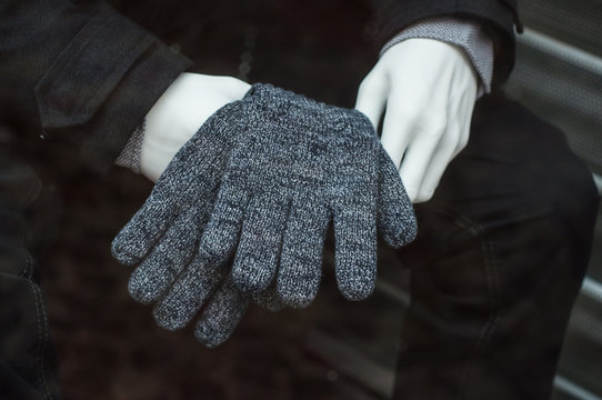 closeup of wool gloves on mannequin in fashion store showroom for men