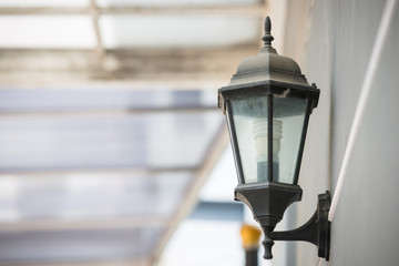 Light bulb and lamp on gray brick wall background as interior design concept.