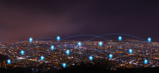 pin flat above night cityscape and glowing networking connection as communication concept Wall mural