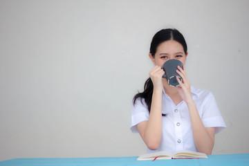 Portrait of thai adult student university uniform beautiful drinking coffee