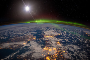 Ireland, United Kingdom and Scandinavia on a moonlit night under an amazing aurora. The elements of this image furnished by NASA.