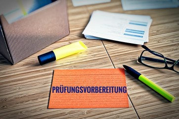 Index cards with legal issues with glasses, pen and bamboo with the german word Examensvorbereitung in english exam preparation