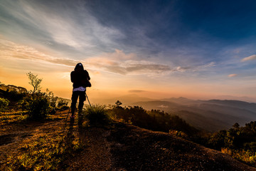photographers take a picture of the sunrise at Doi Inthanon, Chiang Mai, Thailand