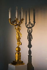Antique chandelier and its shadow. Inside the interiors of the Pavlovsk Palace.