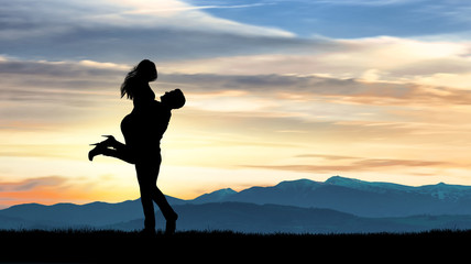 Landscape with silhouette of young couple against colorful sky. Couple, lovers, relationship