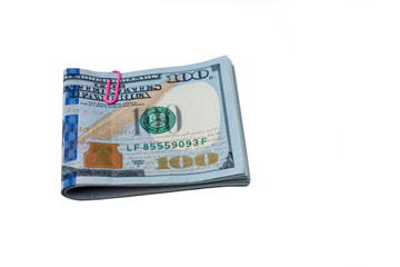 A pack of hundred dollar bills on a white background.