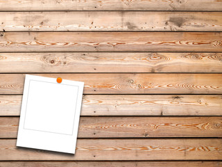 Blank square instant photo frame on brown wooden boards background