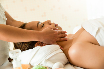 Beautiful woman receiving head massage in spa salon, Relaxing, spa accessories, Healthcare Concept.