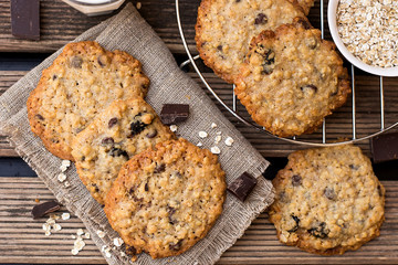Oatmeal cookies with chocolate served with milk