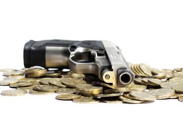 Pistol over heap of coins