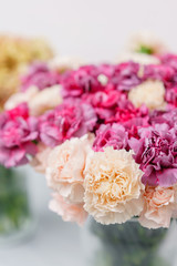 Bouquet of carnation flowers pink and violet color. Spring background. Clove bunch present for Mothers Day.
