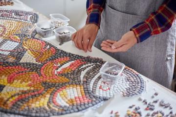 Crop artist composing mosaic