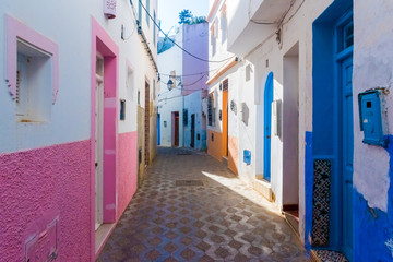 Colorful beautiful street of white ancient medina of the Asilah village in Morocco